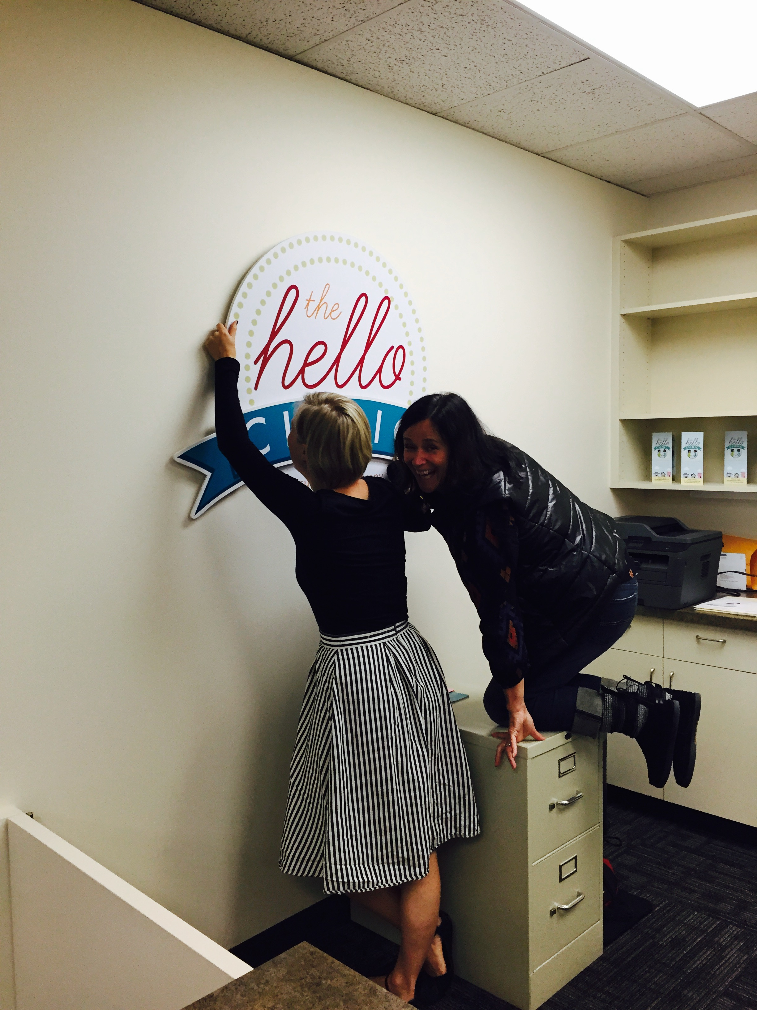 Jenny and Meagan, proving that signs don't just hang themselves.