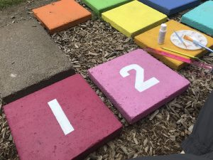 Colorful painted Hopscotch stepping stones backyard project