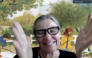 helen clapping with picture book virtual background