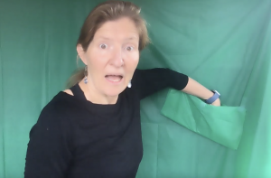 kira with green screen pocket for virtual speech therapy