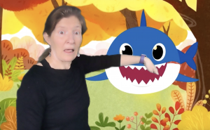 kira with shark virtual background for speech therapy