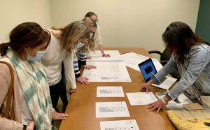 Staff looking at plans for new clinic layout