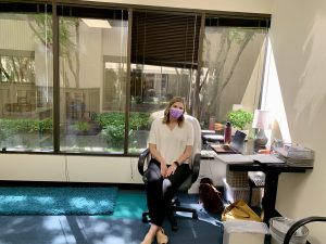 Sarah in sunny new clinic office.