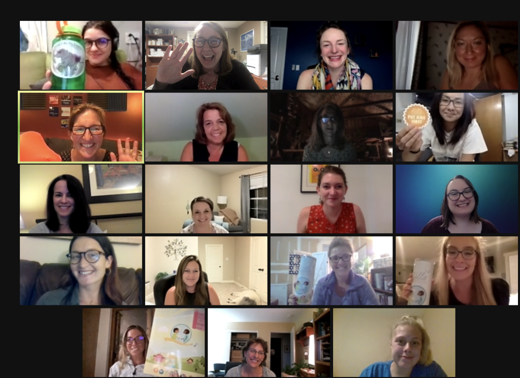 zoom grid with 19 people smiling, waving, and holding up THF swag